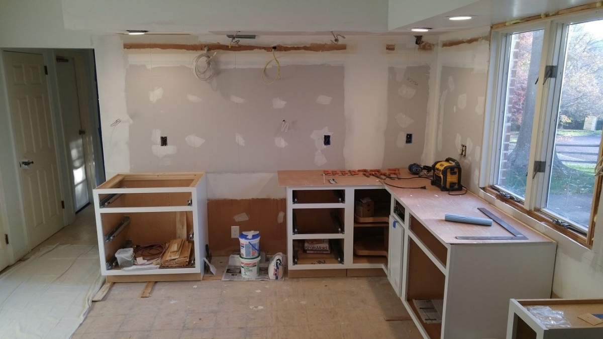 Rough wiring for new lighting and rough plumbing has been completed to  accommodate the new layout. The walls have been put back together and new  White ...